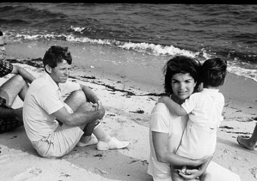 bobby-kennedy-looks-at-jackie-kennedy-holding-her-son-in-the-summer-of-1964