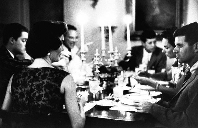 Jacqueline and Robert Kennedy at a dinner party hosted by the Kennedys in Georgetown, June 3, 1957.