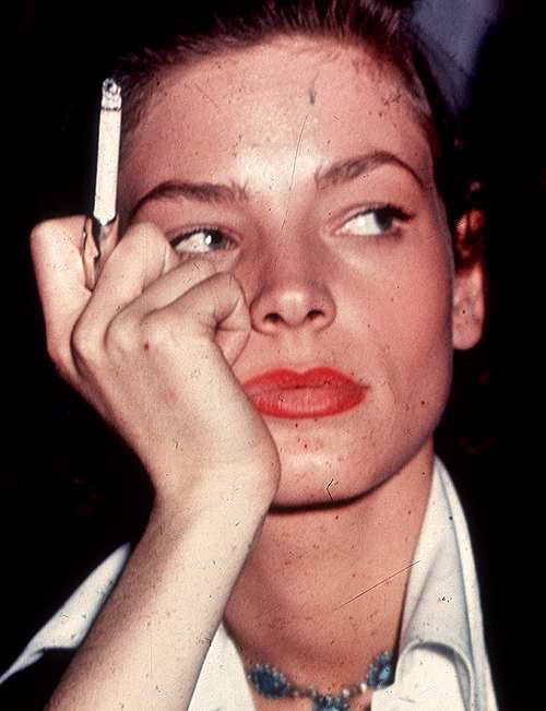 lauren smoking a cigarette on the set of key largo 1948
