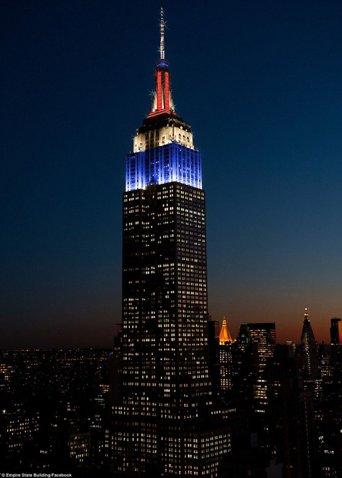 23DD251400000578-2866141-Imperial_welcome_The_Empire_State_Building_was_lit_red_white_and-a-43_1418080544387