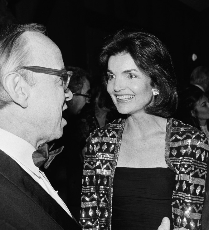 FILE – In this Feb. 22, 1978 file photo, Arthur Schlesinger Jr., left, and Jacqueline Kennedy Onassis speak at a publishing party in New York City. During the first half of 1964, just months after her husband was assassinated, Jacqueline Kennedy sat for seven interviews with Schlesinger, an historian and family friend. Now, with the 50th anniversary of Kennedy's inauguration coming next year, Caroline Kennedy is allowing the conversations to come out. (AP Photo/Richard Drew, File)