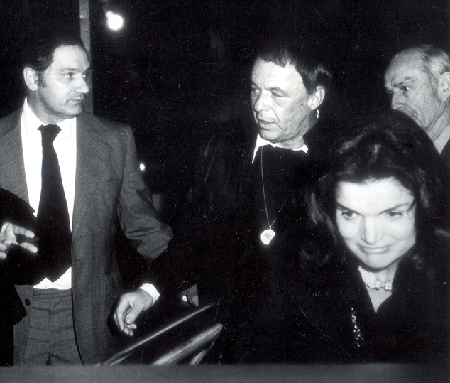 PKT4594-341110 JACQUELINE KENNEDY ONASSIS 1974 Jacqueline Kennedy Onassis and Frank Sinatra leaving Jilly's in New York after Jackie had attended Sinatra's 'COME BACK' concert in Providence R. I. They flew together to Providence and back in his rpivate jet.