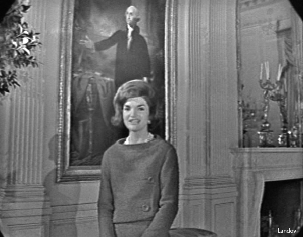 "Image #: 7065946 Jacqueline Kennedy in front of the Gilbert Stuart portrait of George Washington in the East Room during ""A Tour of the White House with Mrs. John F. Kennedy,"" which originally aired on February 14, 1962. CBS /Landov"