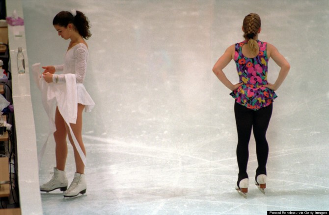 17 FEB 1994: NANCY KERRIGAN AND TONYA HARDING OF THE UNITED STATES PASS EACH OTHER WITHOUT NOTICE DURING A PRACTICE SESSI0N AT THE 1994 LILLEHAMMER WINTER OLYMPICS. Mandatory Credit: Pascal Rondeau/ALLSPORT