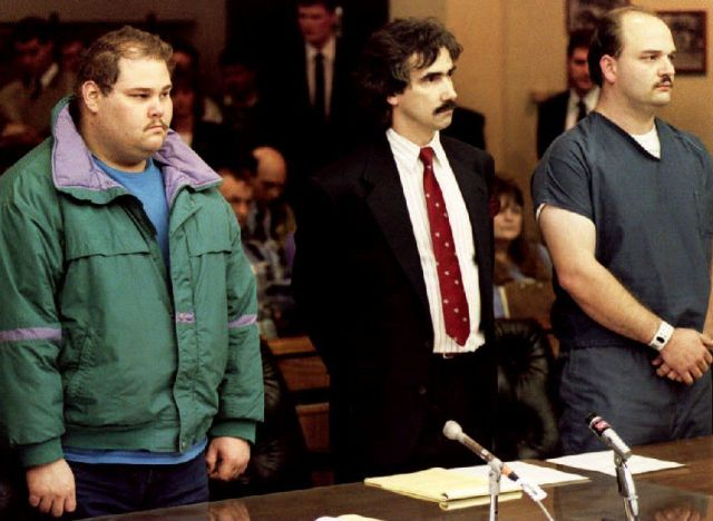PORTLAND, : Shawn Eric Eckardt (L), bodyguard of figure skater Tonya Harding, and fellow defendent Derrick Smith (R) are joined by Smith's attorney Robert Goffredi 14 January 1994 as they face Judge Donald Londer during their arraignment on charges of conspiracy to commit assault in the attack on skater Nancy Kerrigan. The two men were charged for the 06 January 1994 attack on Kerrigan. (Photo credit should read CHRIS WILKINS/AFP/Getty Images)