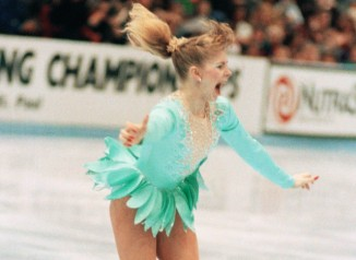A jubilant Tonya Harding acknowledged the crowd as she came out of her successful triple axel on her way to winning the U.S. Figure Skating Championships on Feb. 16, 1991 in Minneapolis. Harding, of Portland, Oregon, became the first American woman to perform a triple axel in competition. (AP Photo/Jim Mone)
