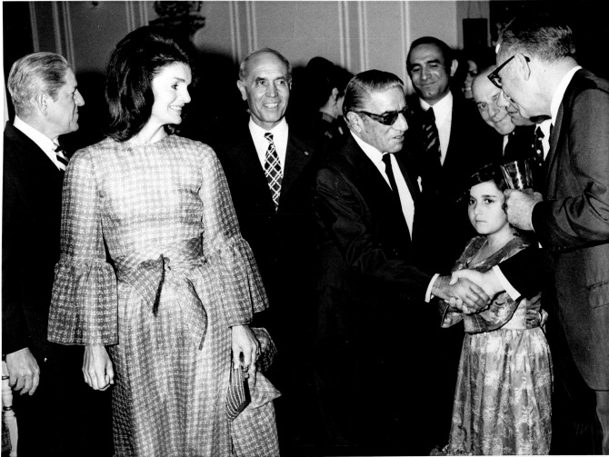 Jacqueline Kennedy Onassis, left, and Aristotle Onassis, wearing dark glasses, appear with host Fallah and his granddaughter in Iran, May 1972. (AP Photo)